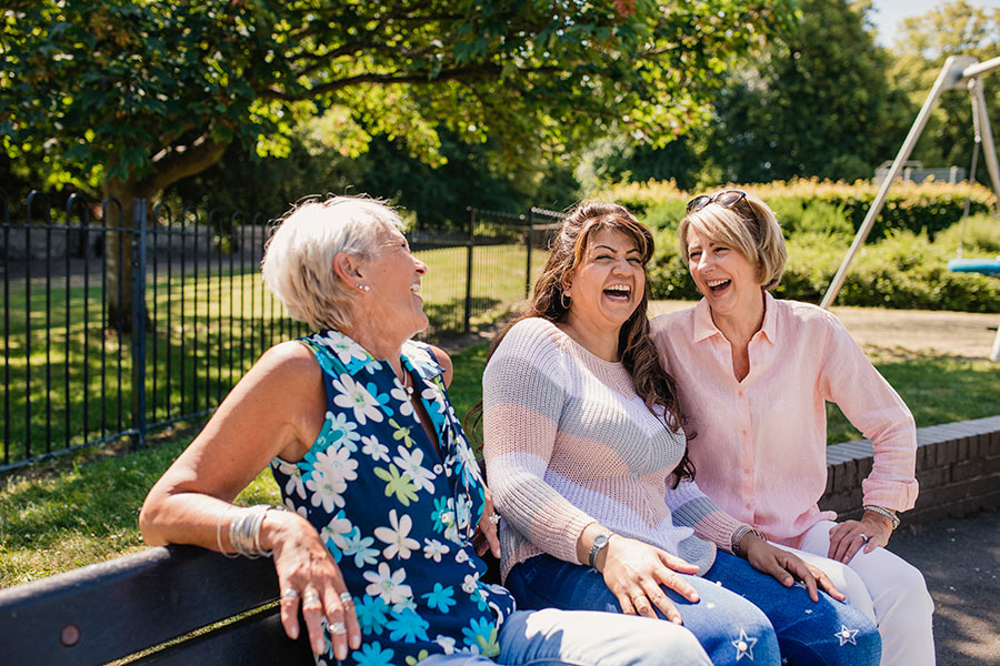 Women talking and laughing in the park