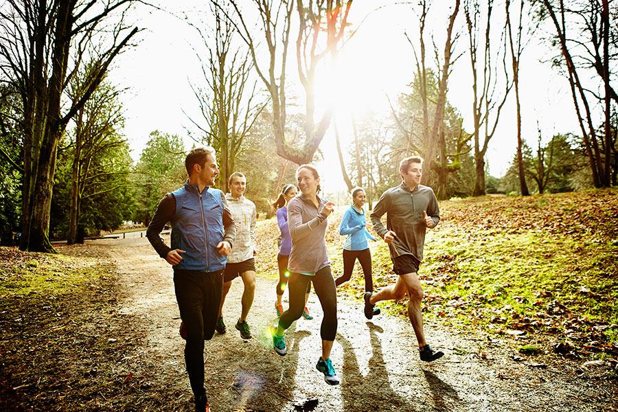 Friends jogging through the park